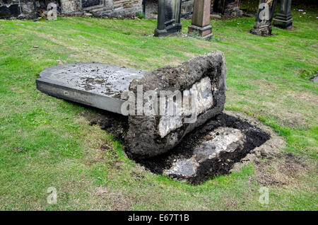 Fallen or toppled headstone in Old Calton Burial Ground, Waterloo Place, Edinburgh, Scotland. - Stock Photo