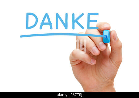 Hand writing Danke with blue marker on transparent wipe board. Thank you in German. - Stock Photo
