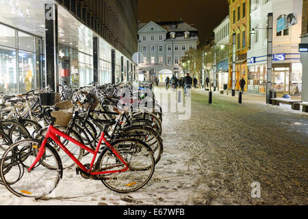 Bike parking and street covered with snow in the center of Aarhus, Denmark, in Scandinavia, Europe - Stock Photo