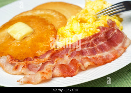 Eggs Bacon and Pancakes, Scrambled Eggs and Pancake Breakfast - Stock Photo