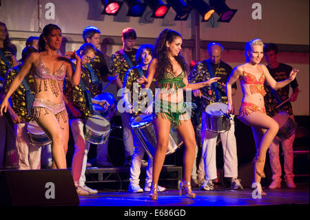 Live music Rhythms of the City samba band on stage with dancers at Brecon Jazz Festival 2014 - Stock Photo