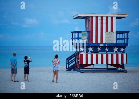 Tourist attraction beach hut on South beach in Miami - Stock Photo