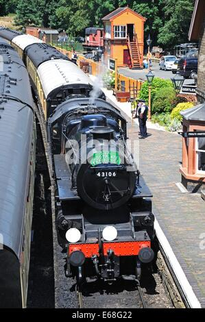 Steam Locomotive Ivatt Class 4 2-6-0 number 43106 in British Rail Black at the railway station, Severn Valley Railway, - Stock Photo
