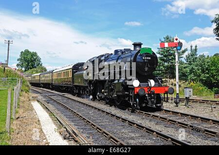 Steam Locomotive Ivatt Class 4 2-6-0 number 43106 in British Rail Black approaching the railway station, Arley, - Stock Photo