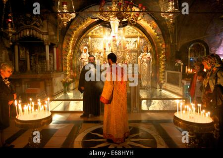 The Stone of Unction, The Church of the Holy Sepulchre, Jerusalem, Israel, Middle East - Stock Photo