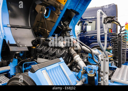Cab compartment opened to expose the engine of a Scania ...