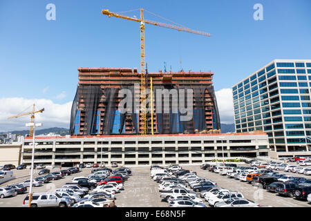 Hawaii Hawaiian Honolulu Ala Moana Center mall office building construction site crane parking lot parked cars economic - Stock Photo