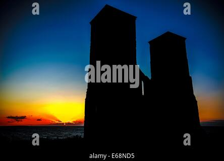 Reculver Castle in Kent, UK at sunset in summer - Stock Photo