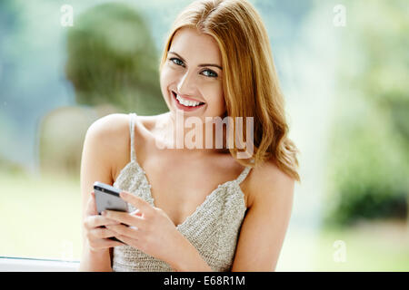 Pretty girl using mobile phone - Stock Photo