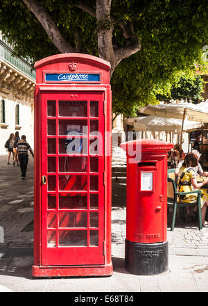 Old red British phone and post boxes together on a Valletta street, Malta. - Stock Photo