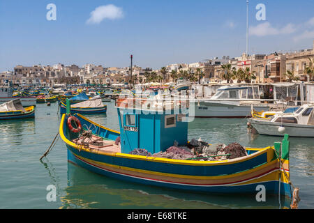 Marsaxlokk harbour with traditional Maltese fishing boat (Luzzu), Malta. - Stock Photo