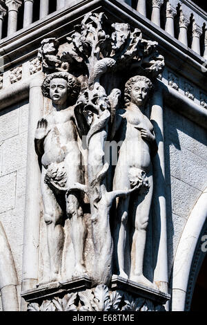 Detail of Antonio Rizzo's Adam and Eve sculpture on the Doge's Palace, Saint Mark's square, Venice, Veneto, Italy. - Stock Photo