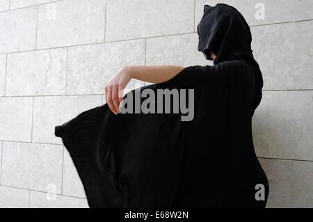Woman in black cape - Stock Photo