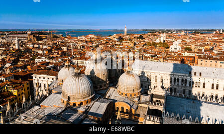 Elevated view looking down on the domes of Saint Mark's Basilica and Venice, Veneto, Italy. - Stock Photo