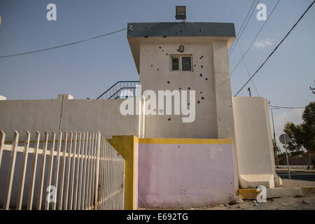 Makhmour, Northern Iraq. 18th Aug, 2014. Makhmour Police station bears the stigma of the recent intense fighting - Stock Photo
