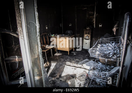 Makhmour, Northern Iraq. 18th Aug, 2014. A shop has been burned down by ISIS militants in Makhmour. Makhmour is - Stock Photo