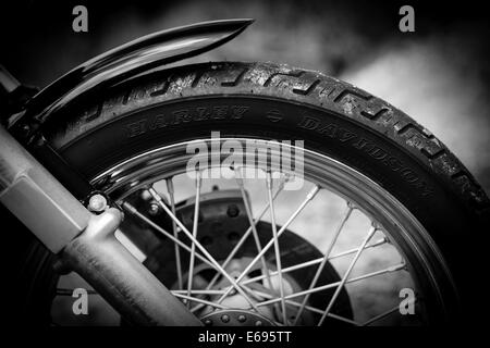 Front wheel of a Harley Davidson motorcycle, close-up - Stock Photo