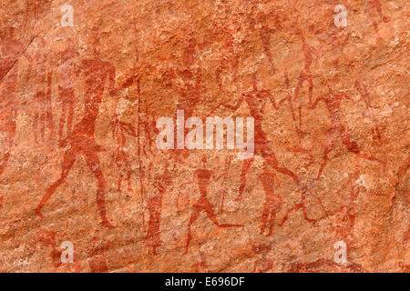 Neolithic rock art, rock painting of hunters and warriors, Bovidian period, Tadrart, Tassili n'Ajjer National Park - Stock Photo