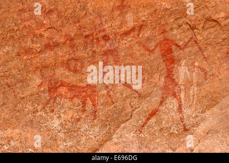 Neolithic rock art, rock painting of cows, bulls and warriors, Bovidian period, Tadrart, Tassili n'Ajjer National - Stock Photo