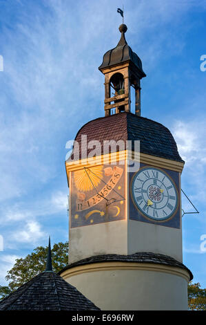 Sundial and a mechanical clock in the clock tower with a time shift in the summertime, 6th castle yard, Burghausen - Stock Photo