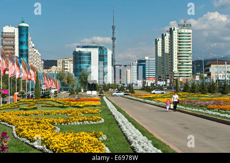 Modern apartment buildings and commercial buildings on Al-Farabi Avenue in the Medeo township, TV tower at the back, - Stock Photo