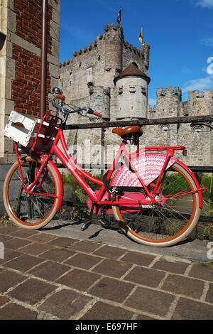 Old bike with the Gravensteen in the bakcground - Stock Photo