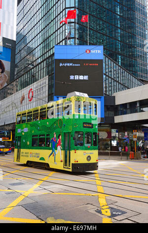 Double-deck tram on the Des Voeux Road, Central Province, Hong Kong Island, China - Stock Photo