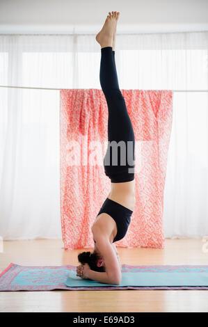 Caucasian woman practicing yoga - Stock Photo