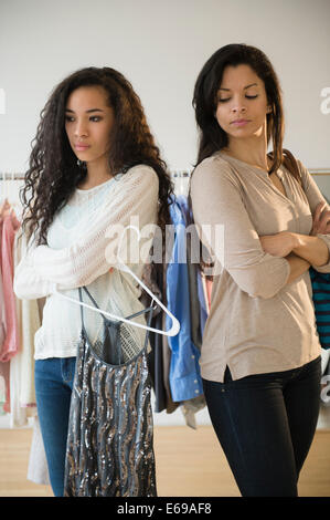 Mother and daughter arguing in store - Stock Photo