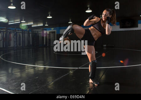 Caucasian fighter training in gym - Stock Photo