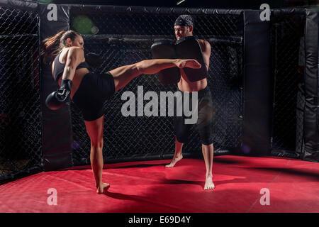 Caucasian fighters training in gym - Stock Photo