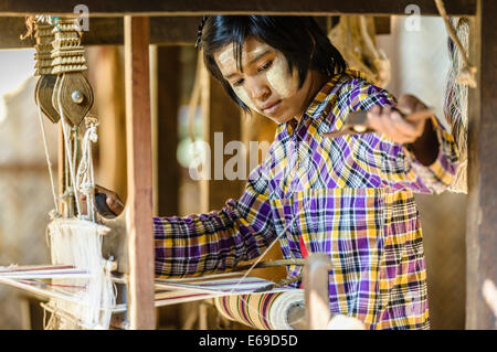 Asian girl weaving fabric - Stock Photo
