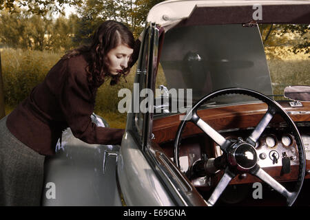 young woman,vehicle breakdown,cabriolet - Stock Photo