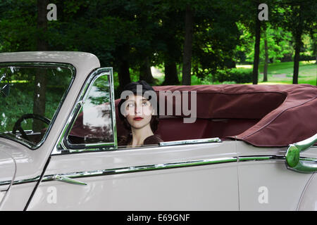 young woman,hat,oldtimer - Stock Photo