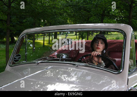 young woman,oldtimer,windshield - Stock Photo