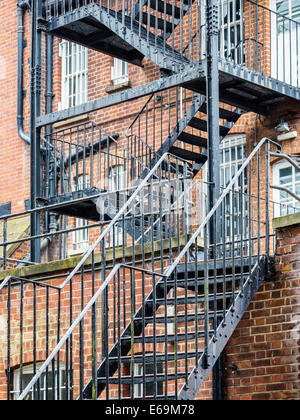 External Metal staircase fire escape on old brick building, Twickenham, Middlesex, Greater London, UK - Stock Photo