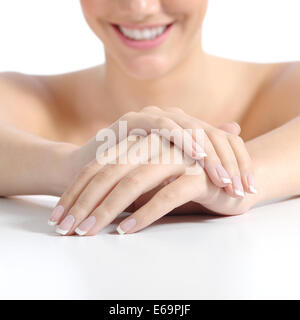 Beautiful woman hands nails with perfect french manicure isolated on a white background - Stock Photo