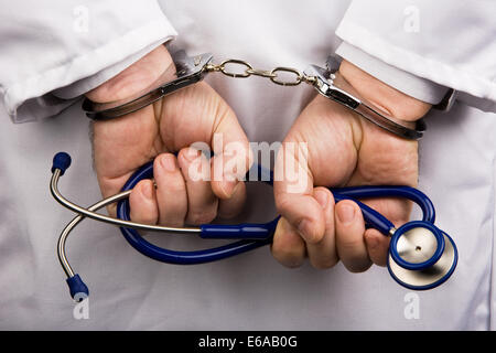 health care,hands tied,insurance fraud - Stock Photo