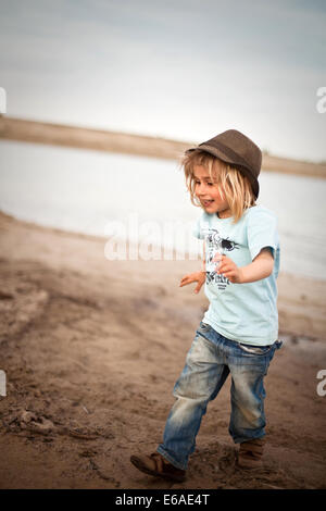 boy,child,happy,fun,happiness,run,dirty,dirt,mud - Stock Photo
