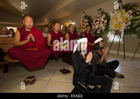 Tibetan monks, family members, mourners, Vietnamese funeral, memorial service, Little Saigon, city of Westminster, - Stock Photo
