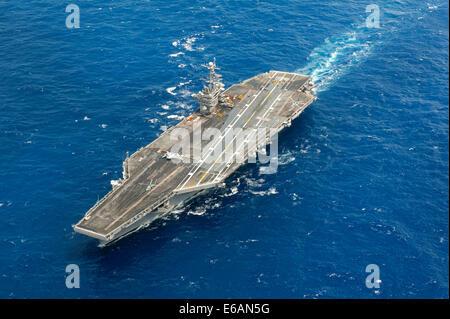The aircraft carrier USS Harry S. Truman (CVN 75) steams through the Atlantic Ocean July 16, 2014. The Harry S. - Stock Photo