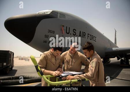 U.S. Air Force Capt. Christopher Carr, 1st Lt. Daniel Winningham and Airman 1st Class Jordan Gese, KC-135 Stratotanker - Stock Photo
