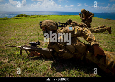 Australian soldiers with Delta Company, 5th Battalion, Royal Australian Regiment conduct a tactical live-fire demonstration - Stock Photo