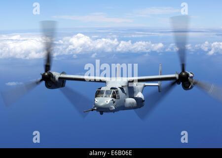 A U.S. Marine Corps MV-22B Osprey tiltrotor aircraft assigned to Marine Medium Tiltrotor Squadron (VMM) 163, 11th - Stock Photo