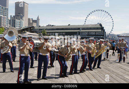 U.S. Marines with the 3rd Marine Aircraft Wing Band give a performance as a part of Marine Week Seattle 2014, at the Seattle Center, Seattle, Wa., July 30, 2014. Marine Week Seattle showcases Marine Corps equipment, aircraft and technological capabilities Stock Photo