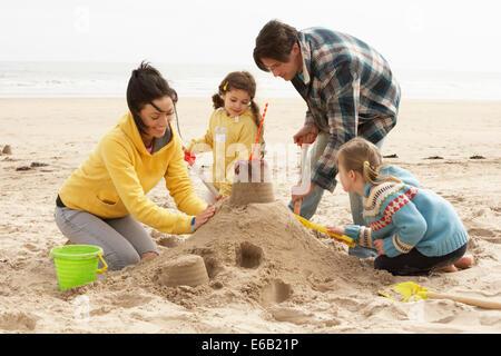 family,sandcastle,beach holiday - Stock Photo