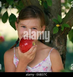 girl,eating,apple,biting - Stock Photo