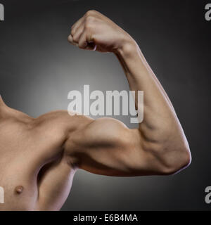 muscular build,bicep,body building - Stock Photo