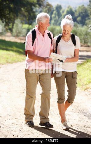 couple,active seniors,hiking,older couple - Stock Photo