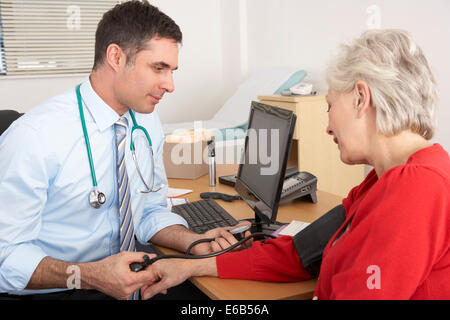 measuring,doctor,patient,blood pressure - Stock Photo